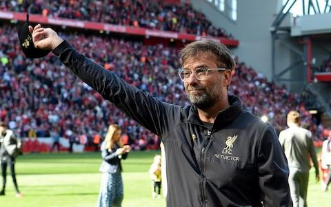 Jurgen Klopp salutes the Kop at Anfield - Credit: Getty images