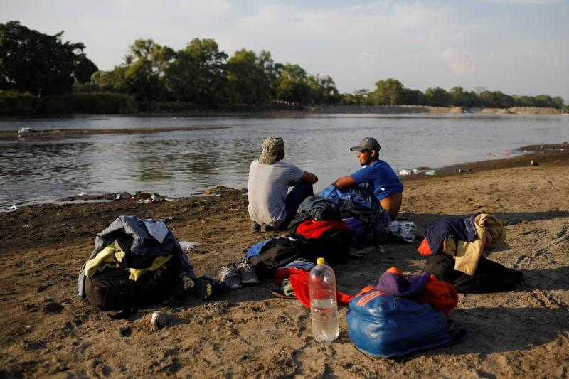 Migrant travelling to the U.S. gather by the Suchiate river at the border between Guatemala and Mexico, in Tecun Uman