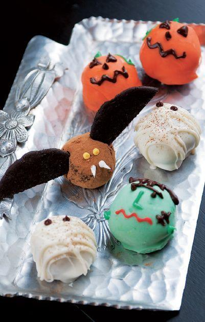 """<p>You can easily transform your classic truffles into a spooky Halloween dessert using multi-colored candy melts. </p><p><a href=""""https://www.womansday.com/food-recipes/food-drinks/a28859104/bewitching-candy-truffles-recipe/"""" rel=""""nofollow noopener"""" target=""""_blank"""" data-ylk=""""slk:Get the Bewitching Candy Truffles recipe."""" class=""""link rapid-noclick-resp""""><strong><em>Get the Bewitching Candy Truffles recipe. </em></strong></a></p>"""