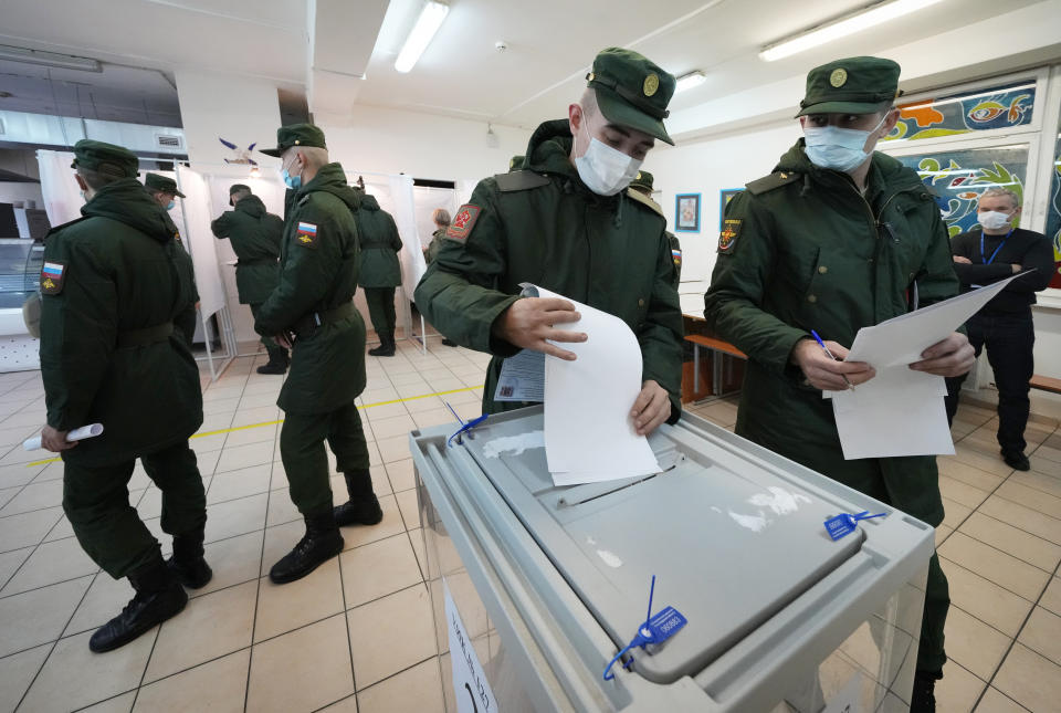 Russian Army soldiers cast their ballots during the State Duma, the Lower House of the Russian Parliament and local parliaments elections at a polling station outside St. Petersburg, Russia, Friday, Sept. 17, 2021. Russia has begun three days of voting for a new parliament that is unlikely to change the country's political complexion. There's no expectation that United Russia, the party devoted to President Vladimir Putin, will lose its dominance in the State Duma. (AP Photo/Dmitri Lovetsky)