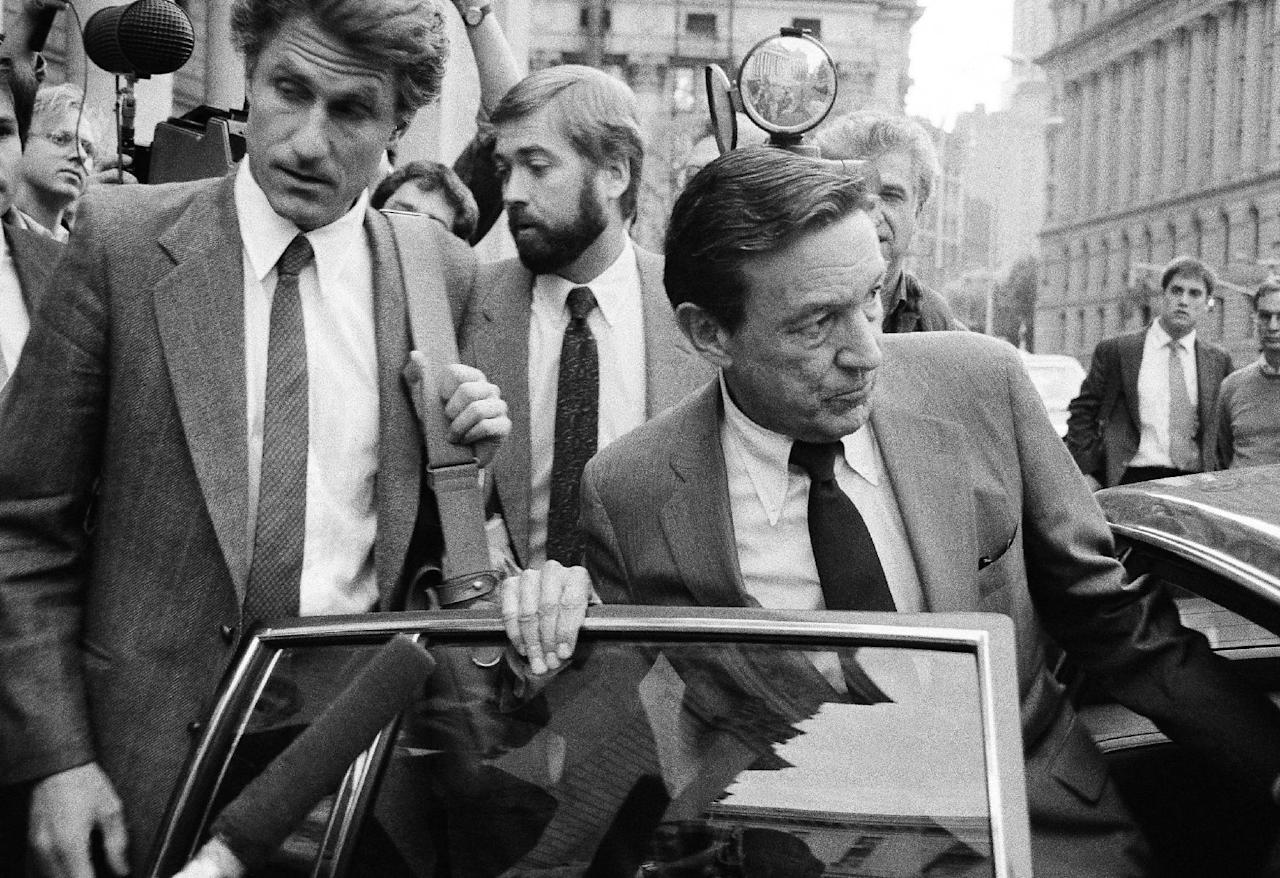 """FILE - In this Oct. 15, 1984 file photo, CBS-TV Correspondent Mike Wallace, right, and producer George Crile, left, leave U.S. District Court in New York, after attending the trial of a libel suit brought by former Gen. William C. Westmoreland against CBS -TV. Wallace, the dogged, merciless reporter and interviewer who took on politicians, celebrities and other public figures in a 60-year career highlighted by the on-air confrontations that helped make """"60 Minutes"""" the most successful primetime television news program ever, has died. He was 93. (AP Photo/Mario Suriani, File)"""