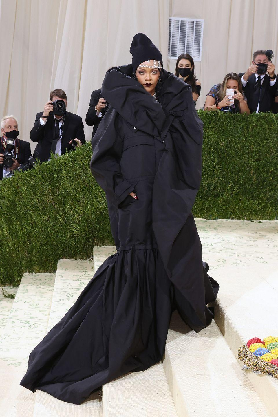 <p>The world's most fabulous billionaire was the absolute last to arrive, showing up swaddled in a massive Balenciaga cloak, dripping diamonds, and topped off with a knit beanie. The ultimate in hi-lo style.</p>