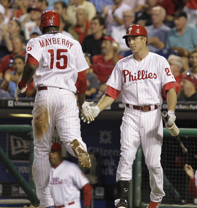 Philadelphia Phillies' John Mayberry Jr. is congratulated by Chase Utley after scoring a run in the third inning against the Colorado Rockies in a baseball game, Tuesday, Aug. 20, 2013, in Philadelphia. (AP Photo/Laurence Kesterson)