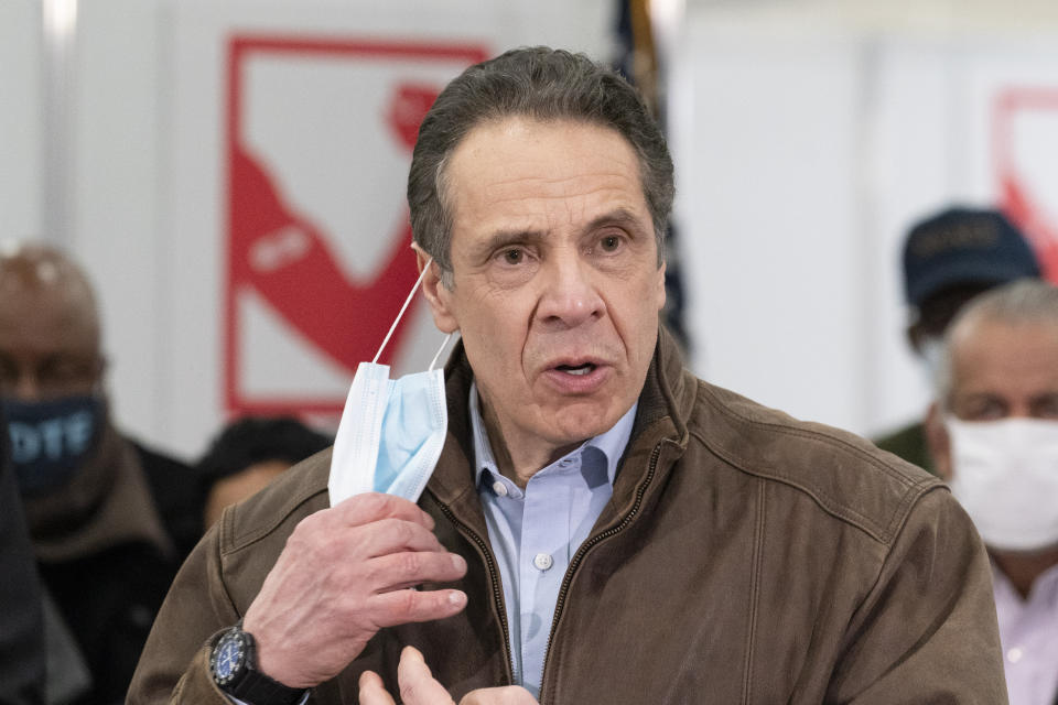 New York Gov. Andrew Cuomo removes his mask during a visit to a COVID-19 vaccination site at State University of New York on March 15, 2021 in Old Westbury, New York. The site is scheduled to open on Friday. (Mark Lennihan-Pool/Getty Images)