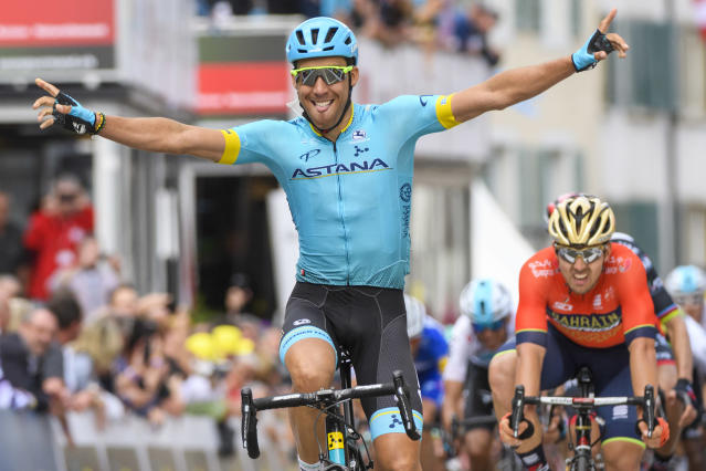 Omar Fraile Matarranz from Spain of team Astana, raises his arms after crossing the finish line to win the first stage, a 166,6 km race between Fribourg and Delemont during the 72th Tour de Romandie UCI ProTour cycling race in Delemont, Switzerland, Wednesday, April 25, 2018. (Jean-Christophe Bott/Keystone via AP)