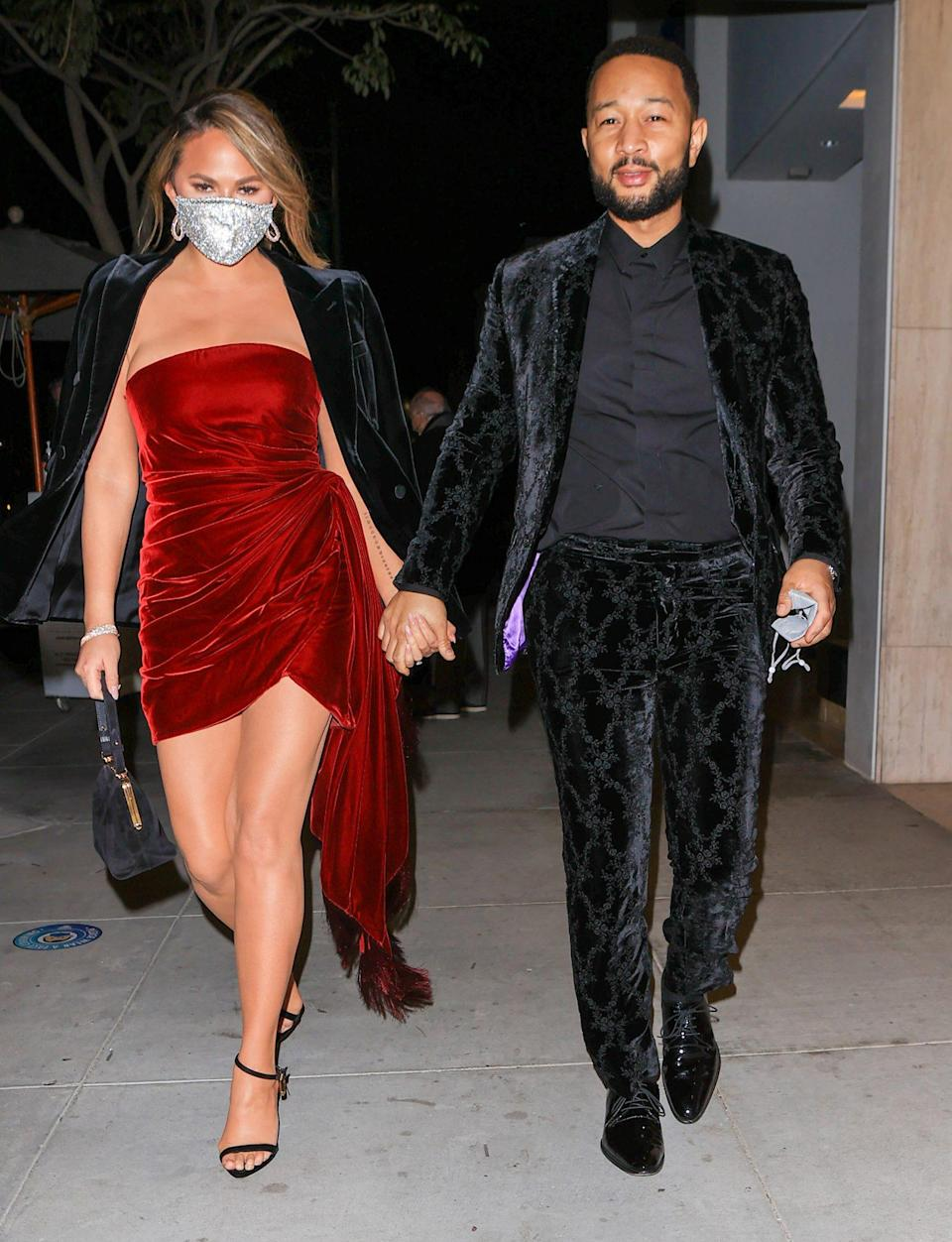 <p>After his Grammys win on Sunday night, a dressed-up Chrissy Teigen and John Legend head out in L.A. </p>