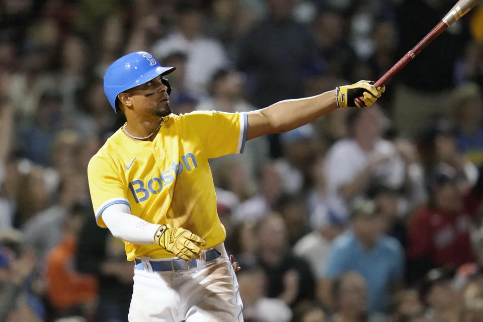 Boston Red Sox's Xander Bogaerts watches the flight of his two-run home run in the fifth inning of a baseball game against the New York Mets at Fenway Park, Tuesday, Sept. 21, 2021, in Boston. (AP Photo/Charles Krupa)