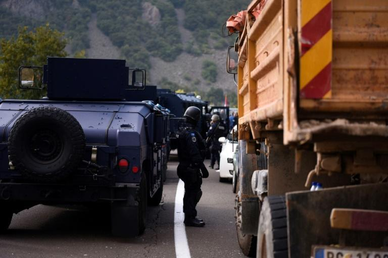 The protesters used trucks and cars to completely shut down traffic on the roads (AFP/Armend NIMANI)