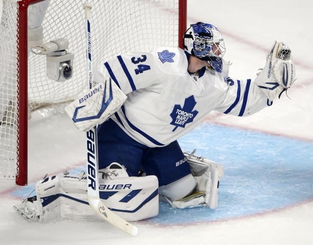 Toronto Maple Leafs goalie James Reimer (34) makes a save against the Montreal Canadiens during first period of an NHL hockey game on Tuesday, Oct. 1, 2013, in Montreal. Toronto won the season opener 4-3. (AP Photo/The Canadian Press, Ryan Remiorz)