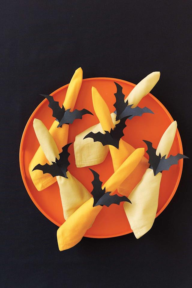 "<p>Spice up your dinner plate with these spooky napkin holders. Plus, all this design takes is black construction paper.</p><p><strong><a rel=""nofollow"" href=""https://www.womansday.com/home/crafts-projects/how-to/a5996/halloween-craft-how-to-bat-napkin-rings-123823/"">Get the tutorial.</a></strong><br></p><p><strong>Tools you'll need:</strong> tracing paper ($8, <a rel=""nofollow"" href=""https://www.amazon.com/Darice-9-Inch-by-12-Inch-Tracing-Paper-100-Sheets/dp/B004GXBXSK"">amazon.com</a>), black construction paper ($2, <a rel=""nofollow"" href=""https://www.amazon.com/Pacon-Construction-9-Inches-12-Inches-103607/dp/B00006IDOY"">amazon.com</a>)<br></p>"