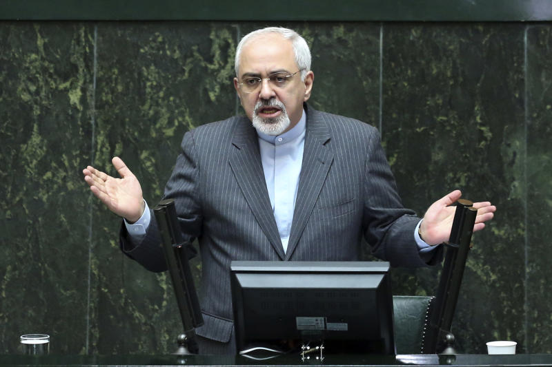 Iranian Foreign Minister Mohammad Javad Zarif speaks in the parliament in Tehran, Iran, Wednesday, Nov. 27, 2013. Hard-line Iranian politicians publicly criticized the deal reached in Geneva last week over the Islamic Republic's nuclear program, an agreement that has largely been welcomed by Iranians. (AP Photo/Ebrahim Noroozi)