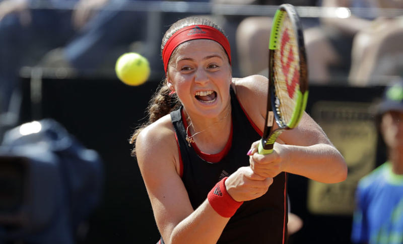 FILE - In this May 18, 2018, file photo, Latvia's Jelena Ostapenko returns the ball to Russia's Maria Sharapova at the Italian Open tennis tournament in Rome. Ostapenko will be competing in the French Open tennis tournament that begins on Sunday, May 27.(AP Photo/Andrew Medichini, File)