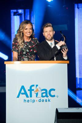 ACM nominee Carly Pearce presents Aflac ACM Lifting Lives Honor recipient Brandon Ray with his trophy in Las Vegas on April 5, 2019, in advance of the 54th Academy of Country Music Awards®.