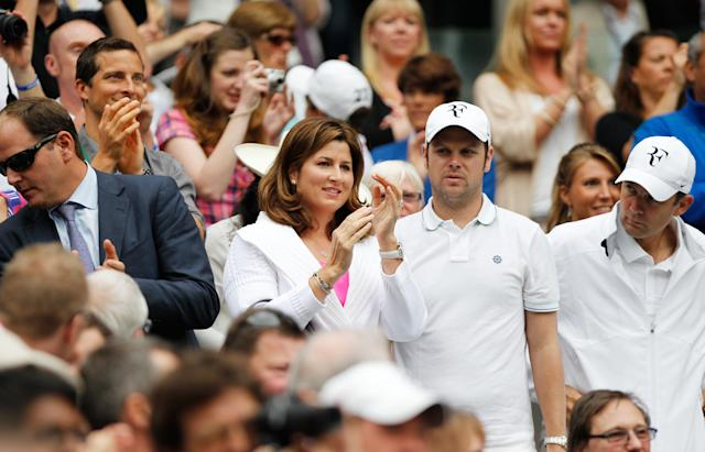 LONDON, ENGLAND - JUNE 27: Miroslava 'Mirka' Federer applauds from the crowd as Roger Federer of Switzerland beats Fabio Fognini of Italy in their Gentlemen's Singles second round match on day three of the Wimbledon Lawn Tennis Championships at the All England Lawn Tennis and Croquet Club on June 27, 2012 in London, England. (Photo by Paul Gilham/Getty Images)