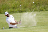 United States' Dustin Johnson plays out of a bunker on the 6th green during a practice round for the British Open Golf Championship at Royal St George's golf course Sandwich, England, Tuesday, July 13, 2021. The Open starts Thursday, July, 15. (AP Photo/Peter Morrison)