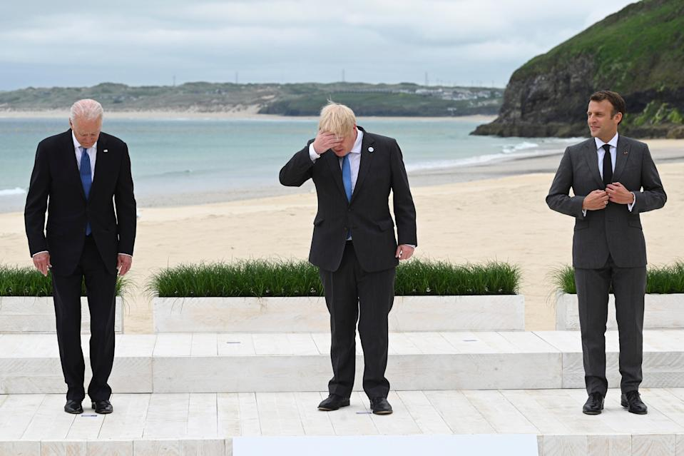 Headache: Boris Johnson lines up between presidents Joe Biden (left) and Emmanuel Macron as the G7 leaders gather for a group photo session in Carbis Bay, Cornwall, on Friday (AP)