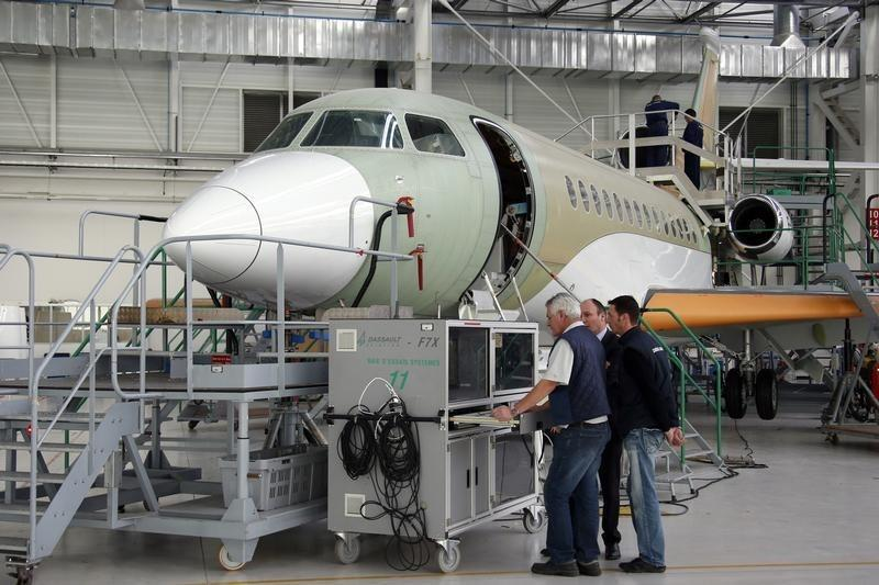 Employees work on the assembly line of the Falcon 7X aircraft in the factory of French aircraft manufacturer Dassault Aviation in Merignac near Bordeaux