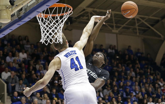 Duke's Jack White (41) blocks Stetson's Keith Matthews during the first half of an NCAA college basketball game in Durham, N.C., Saturday, Dec. 1, 2018. (AP Photo/Gerry Broome)