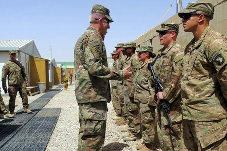 U.S. Army General John Nicholson, commander of Resolute Support forces and U.S. forces in Afghanistan, talks to U.S. soldiers during a transfer of authority ceremony at Shorab camp, in Helmand province, Afghanistan April 29, 2017. Picture taken April 29, 2017. REUTERS/James Mackenzie