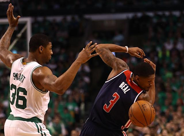 <p>BOSTON, MA – MAY 15: Marcus Smart #36 of the Boston Celtics defends against Bradley Beal #3 of the Washington Wizards during Game Seven of the NBA Eastern Conference Semi-Finals at TD Garden on May 15, 2017 in Boston, Massachusetts. NOTE TO USER: User expressly acknowledges and agrees that, by downloading and or using this photograph, User is consenting to the terms and conditions of the Getty Images License Agreement. (Photo by Elsa/Getty Images) </p>