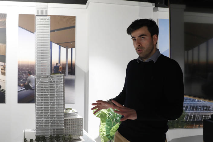 Kevin Darvishi leasing Director for the 8 Bishopsgate development speaks to the Associated Press at their marketing suite in London, Thursday, April 1, 2021. Darvishi said demand for top-quality office buildings will remain strong in the post-pandemic world.(AP Photo/Alastair Grant)