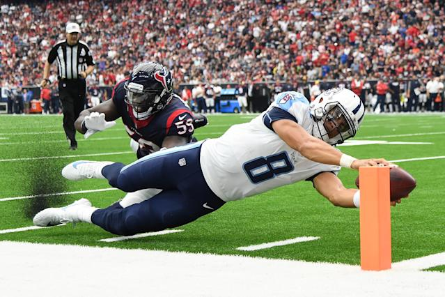 <p>Tennessee Titans quarterback Marcus Mariota (8) scores a touchdown ahead of Houston Texans outside linebacker Whitney Mercilus (59) during the second quarter at NRG Stadium. Mandatory Credit: Shanna Lockwood-USA TODAY Sports </p>