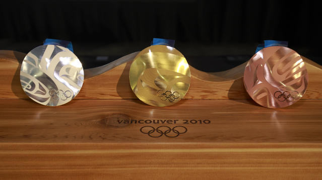 "<p>The Vancouver 2010 medals were inspired by the snow, seas, and landscape of British Columbia. The wavy shape is a first, and <a href=""http://www.mint.ca/store/mint/learn/medals-the-story-4400010#.WobdoxPwZTY"" rel=""nofollow noopener"" target=""_blank"" data-ylk=""slk:each medal is unique"" class=""link rapid-noclick-resp"">each medal is unique</a>.<br>(Photo by Jeff Vinnick/Getty Images) </p>"