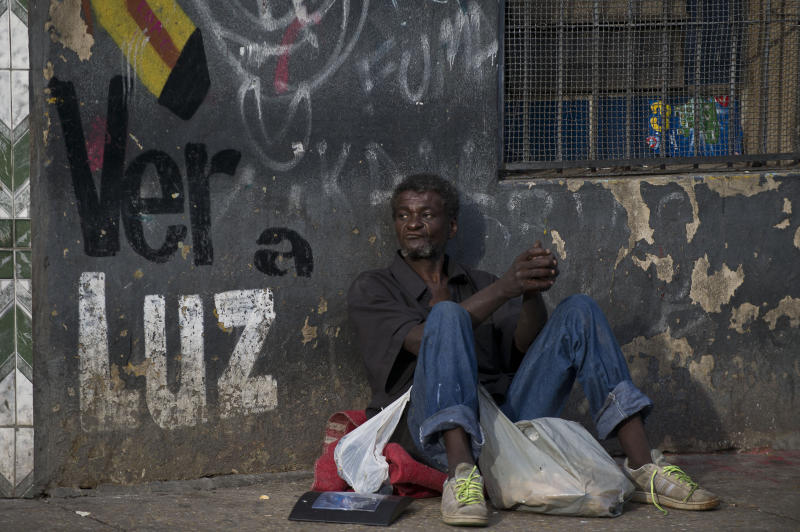 "A man sits on the street in ""Cracolandia"" (Crackland), in downtown Sao Paulo, Brazil on January 15, 2014. AFP PHOTO/Nelson ALMEIDA (Photo credit should read NELSON ALMEIDA/AFP via Getty Images)"