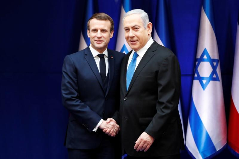 Israeli Prime Minister Benjamin Netanyahu and French President Emmanuel Macron shake hands during their meeting in Jerusalem