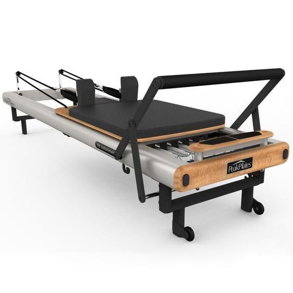 """<p><strong>Peak Pilates</strong></p><p>overstock.com</p><p><strong>$2069.98</strong></p><p><a href=""""https://go.redirectingat.com?id=74968X1596630&url=http%3A%2F%2Fwww.overstock.com%2FSports-Toys%2FPeak-Pilates-fit-Reformer%2F9172995%2Fproduct.html&sref=https%3A%2F%2Fwww.womenshealthmag.com%2Ffitness%2Fg32850611%2Fbest-pilates-reformer-machine%2F"""" rel=""""nofollow noopener"""" target=""""_blank"""" data-ylk=""""slk:Shop Now"""" class=""""link rapid-noclick-resp"""">Shop Now</a></p><p>This is a super solid Pilates machine without all the other bells and whistles. As such the price point is about half that of a high-end reformer, but it'll still stand up to every reformer exercise like a pro. </p><p><strong>Reviewer rave: </strong>""""I got this reformer for my home studio. It's a well build and solid reformer. Very smooth gliding of the carriage. The bed, straps and the handles well padded and great quality! The frame is heavy and solid! Overall a great reformer!""""</p>"""