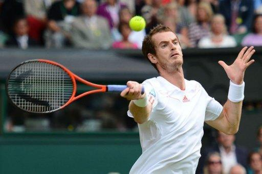 Britain's Andy Murray plays a forehand shot during his men's singles quarter-final match against Spain's David Ferrer on day nine of the 2012 Wimbledon Championships tennis tournament at the All England Tennis Club in Wimbledon, southwest London. Murray survived a gruelling examination from Spain's David Ferrer to reach the Wimbledon semi-finals for the fourth successive year