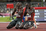 Emmanuel Korir, right, of Kenya, celebrates after winning the gold medal with silver medalist Ferguson Rotich, also of Kenya, in the men's 800-meter final at the 2020 Summer Olympics, Wednesday, Aug. 4, 2021, in Tokyo. (AP Photo/Petr David Josek)