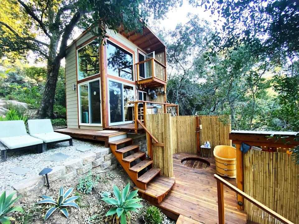 """<h2><a href=""""http://airbnb.pvxt.net/NnR3O"""" rel=""""nofollow noopener"""" target=""""_blank"""" data-ylk=""""slk:ShangriLaLa Tiny House Mountaintop Getaway"""" class=""""link rapid-noclick-resp"""">ShangriLaLa Tiny House Mountaintop Getaway</a></h2><br><strong>Summary:</strong> """"This space is thoughtfully designed to provide a luxury outdoor/indoor experience. Earth tones from the cedar wood walls & ceilings, as well as bamboo floors, make the indoor space feel welcoming and warm. Plush pillows and soft carpets add a cozy touch, while floor to ceiling windows invite the beauty of nature into the space, making it feel expansive. The bedroom space is lofted and accessible by a beautifully handcrafted stepladder. Waking up here you feel like you are floating amongst the trees!""""<br><br><strong>Location: </strong>Topanga, California<br><strong>Sleeps: </strong>2<br><strong>Price Per Night: </strong>$201<br><br><strong><em><a href=""""http://airbnb.pvxt.net/NnR3O"""" rel=""""nofollow noopener"""" target=""""_blank"""" data-ylk=""""slk:Book Now"""" class=""""link rapid-noclick-resp"""">Book Now</a></em></strong>"""