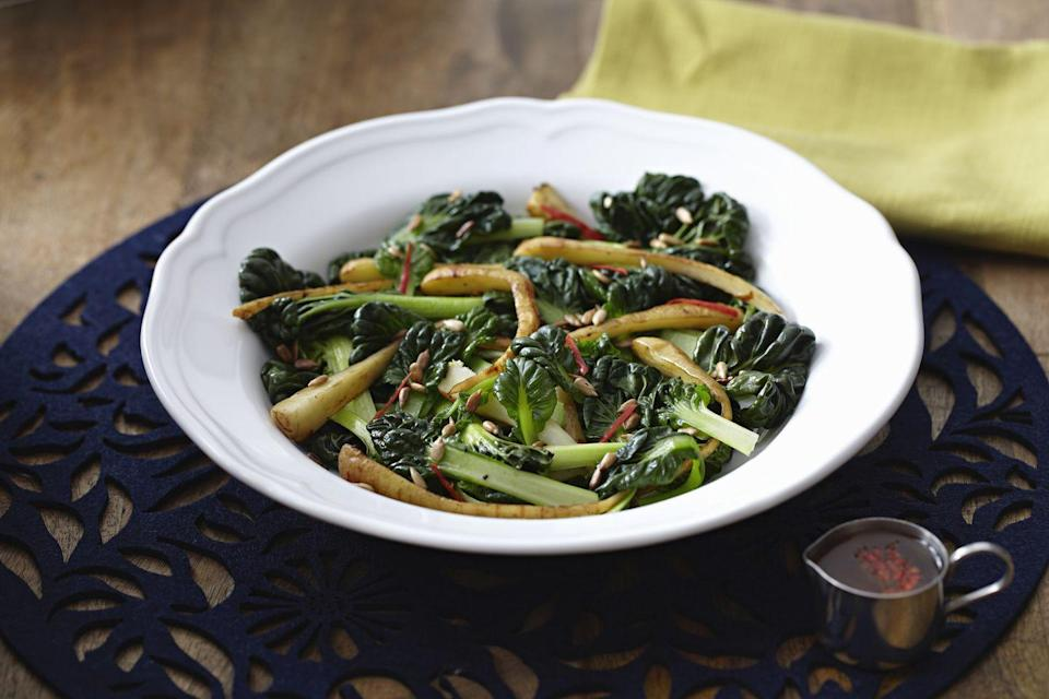 """<p>""""like all leafy greens, Swiss chard is low in calories, with just 7 per cup raw of 35 cooked,"""" Bauer says. """"Plus, it's chock-full of <a href=""""https://www.healthline.com/nutrition/swiss-chard"""" rel=""""nofollow noopener"""" target=""""_blank"""" data-ylk=""""slk:important vitamins and minerals"""" class=""""link rapid-noclick-resp"""">important vitamins and minerals</a>, and will bring pretty color to your plate.""""</p><p><strong>Recipe to try: </strong><a href=""""https://www.womansday.com/food-recipes/food-drinks/recipes/a9560/swiss-chard-walnuts-120732/"""" rel=""""nofollow noopener"""" target=""""_blank"""" data-ylk=""""slk:Swiss Chard with Walnuts"""" class=""""link rapid-noclick-resp"""">Swiss Chard with Walnuts</a></p>"""