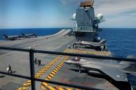F-35B Lightning II aircrafts are seen on the deck of the HMS Queen Elizabeth aircraft carrier offshore Portugal