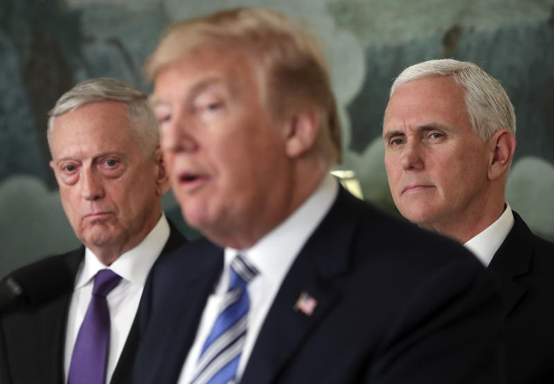 "FILE - In this March 23, 2018 file photo, Defense Secretary Jim Mattis, left, and Vice President Mike Pence, right, listen to President Donald Trump, center, speaks in the Diplomatic Room of the White House in Washington.  Mattis warns bitter political divisions have pushed American society to the ""breaking point"" in his most extensive public remarks since he resigned in protest from the Trump administration.  (AP Photo/Pablo Martinez Monsivais)"