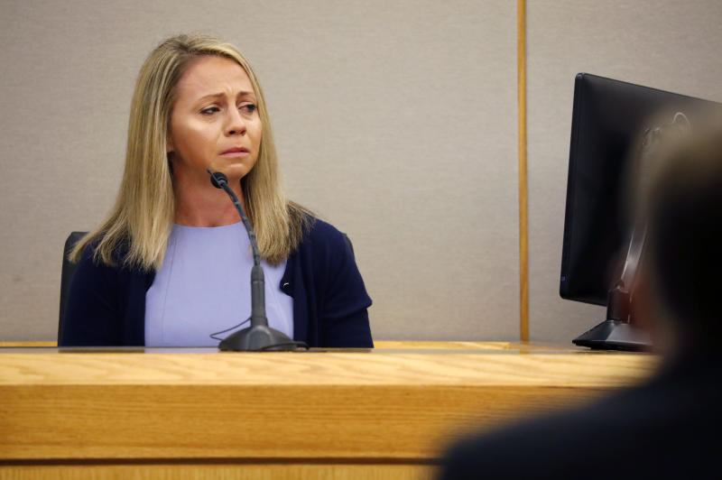 Fired Dallas police officer Amber Guyger becomes emotional as she testifies in her murder trial, Friday, Sept. 27, 2019, in Dallas. Guyger is accused of shooting and killing Botham Jean, an unarmed 26-year-old neighbor in his own apartment last year. She told police she thought his apartment was her own and that he was an intruder. (Tom Fox/The Dallas Morning News via AP, Pool)