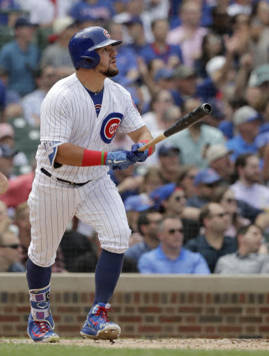 Chicago Cubs' Kyle Schwarber watches his home run off Los Angeles Dodgers' Ross Stripling during the fourth inning of a baseball game Wednesday, June 20, 2018, in Chicago. (AP Photo/Charles Rex Arbogast)