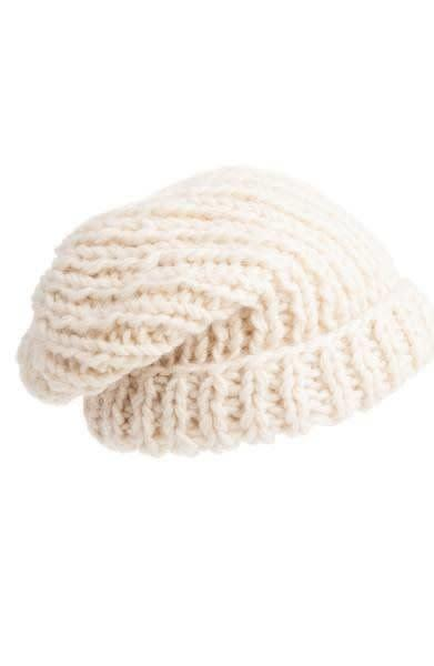 This <span>slouchy cap</span> can suit any thickness of hair with its adjustable fold-over cuff.