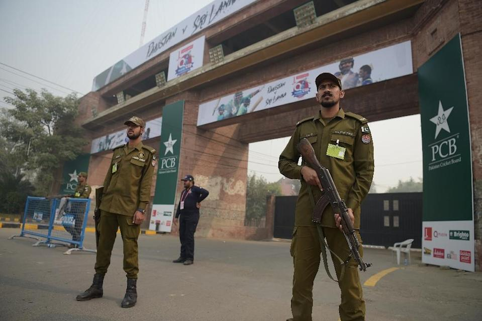 Pakistani policemen stand guard at the entrance of the Gaddafi Cricket Stadium in Lahore on October 28, 2017, on the eve of Pakistan's final Twenty20 match against Sri Lanka (AFP Photo/AAMIR QURESHI)