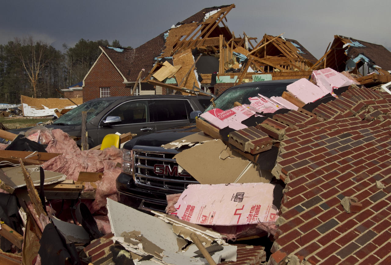 A tornado left a path of destruction as it passed through, Friday, March. 2, 2012, in Athens, Ala. Powerful storms stretching from the Gulf Coast to the Great Lakes flattened buildings in several states, wrecked two Indiana towns and bred anxiety across a wide swath of the country in the second powerful tornado outbreak this week. (AP Photo/Butch Dill)
