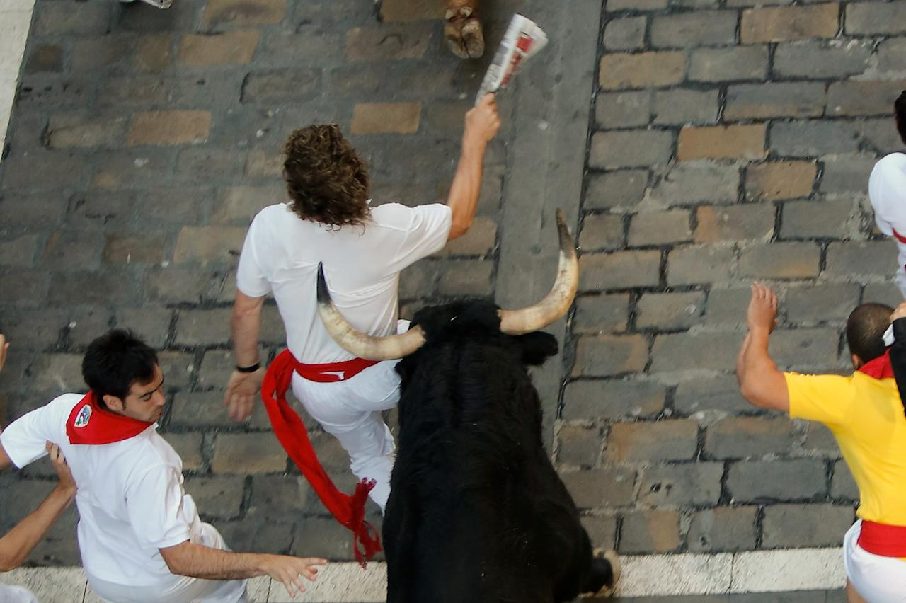 PAMPLONA, SPAIN - JULY 09: A Valdefresno fighting bull's horn pushes a reveller at Calle Estafeta during the fourth day of the San Fermin Running Of The Bulls festival, on July 9, 2013 in Pamplona, Spain. The annual Fiesta de San Fermin, made famous by the 1926 novel of US writer Ernest Hemmingway 'The Sun Also Rises', involves the running of the bulls through the historic heart of Pamplona, this year for nine days from July 6-14. (Photo by Pablo Blazquez Dominguez/Getty Images)