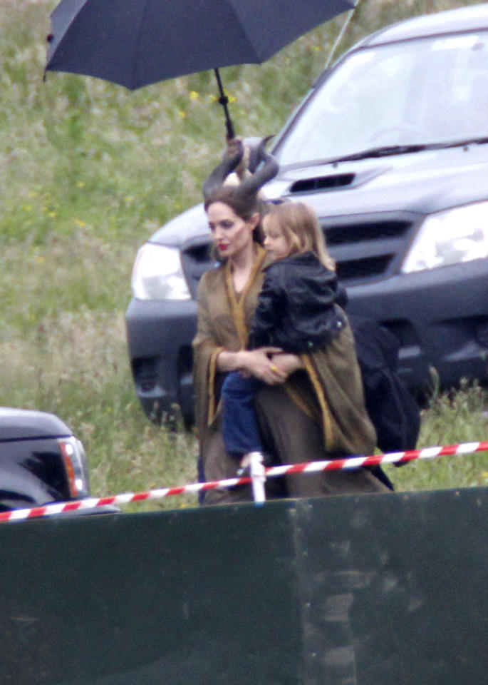 "Another celeb brought her kids to work this week. Angelina Jolie took time out from her latest movie role (but not her character's horns) on the U.K. set of the Disney film ""Maleficent"" to cart around her youngest daughter Vivienne, who, along with her twin brother Knox, turns 4 on July 12. (6/27/2012)"