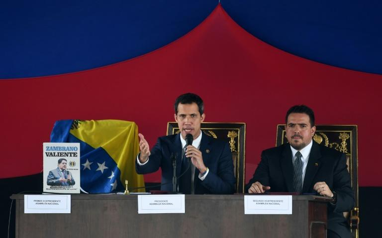 Opposition leader Juan Guaido (C) did not mention foreign intervention during the National Assembly vote to re-join a regional defense treaty (AFP Photo/Yuri CORTEZ)