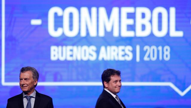 Argentina's President Mauricio Macri and CONMEBOL President Alejandro Dominguez attend the 68th Ordinary CONMEBOL Congress in Buenos Aires, Argentina April 12, 2018. REUTERS/Martin Acosta