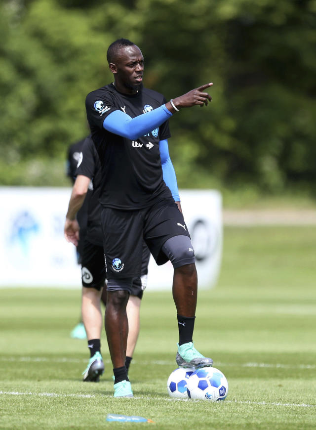 Jamaican athlete Usain Bolt gestures as he takes part in the World XI team's training session, prior to the Soccer Aid for UNICEF soccer match, at Motspur Park, London, Friday June 8, 2018. (Steven Paston/PA via AP)