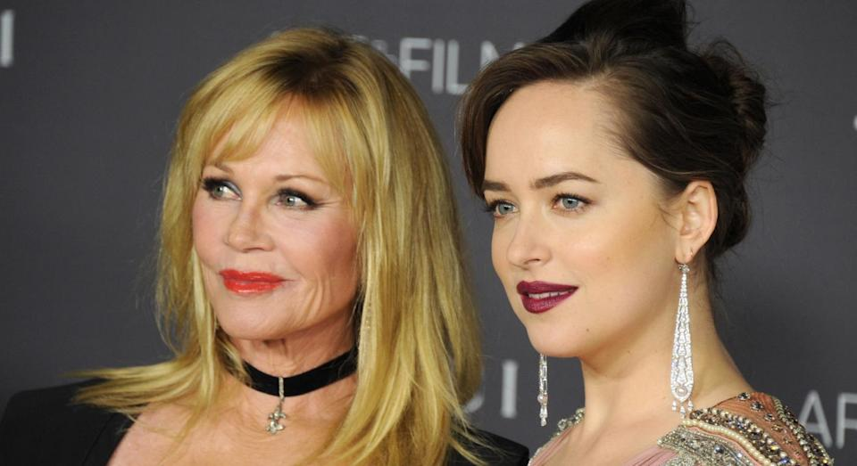 Mum and daughter, Melanie Griffith and Dakota Johnson are hogging the good gene pool. [Photo: Getty]