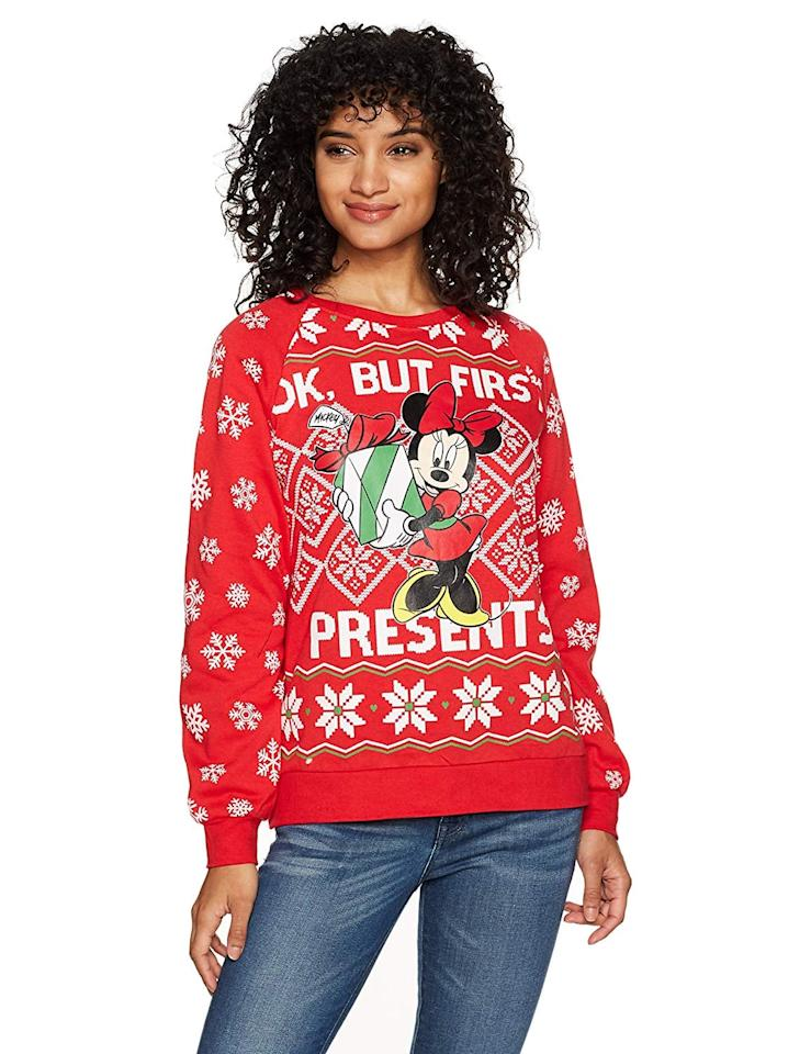 "<p>Stay cozy in this <a href=""https://www.popsugar.com/buy/Disney-Minnie-Presents-Christmas-Sweater-384132?p_name=Disney%20Minnie%20Presents%20Christmas%20Sweater&retailer=amazon.com&pid=384132&price=20&evar1=moms%3Aus&evar9=45483669&evar98=https%3A%2F%2Fwww.popsugar.com%2Fphoto-gallery%2F45483669%2Fimage%2F45483676%2FDisney-Minnie-Presents-Christmas-Sweater&list1=shopping%2Cgifts%2Camazon%2Choliday%2Cchristmas%2Cgift%20guide%2Cdisney&prop13=api&pdata=1"" rel=""nofollow"" data-shoppable-link=""1"" target=""_blank"" class=""ga-track"" data-ga-category=""Related"" data-ga-label=""https://www.amazon.com/Disney-Womens-Presents-Christmas-Sweater/dp/B0746V272X/ref=sr_1_12?s=apparel&amp;ie=UTF8&amp;qid=1542046564&amp;sr=1-12&amp;nodeID=7147440011&amp;psd=1&amp;keywords=disney%2Bchristmas&amp;th=1&amp;psc=1"" data-ga-action=""In-Line Links"">Disney Minnie Presents Christmas Sweater</a> ($20).</p>"