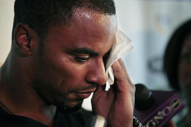 New Orleans Saints safety Darren Sharper wipes his face as he talks during a news conference to announce the Home Run For Kids charity softball game, which benefits charitable organizations such as the American Cancer Society and the Sharper Kids Foundation in Metairie, La., Wednesday, June 1, 2011. (AP Photo/Gerald Herbert)