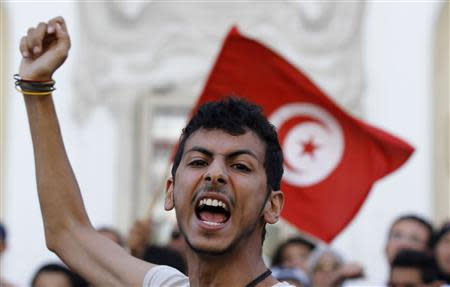 A protester shouts slogans during a demonstration calling for the departure of the Islamist-led ruling coalition in central Tunis